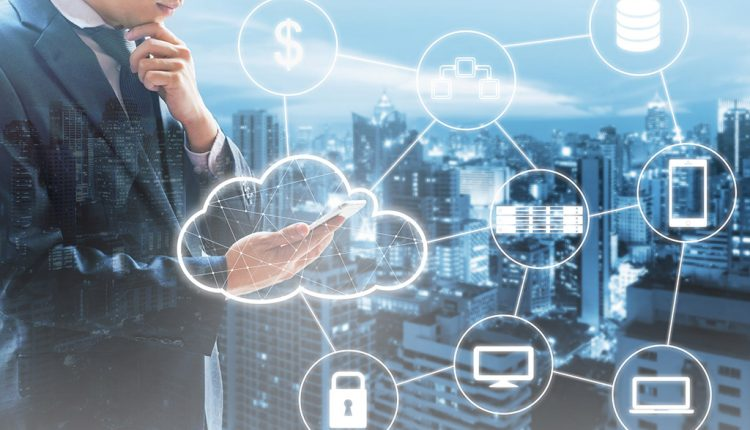 Double exposure of businessman connected Cloud technology with i